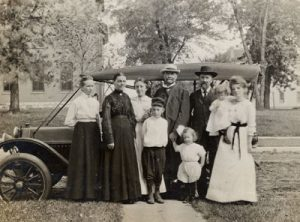 historical photo from Augsburg's archives of founders and family in front of a car