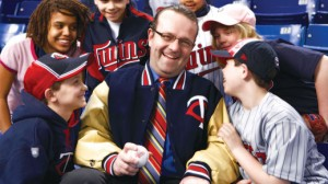 Dave St Peter surrounded by kids in Twins gear