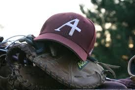 Augsburg baseball cap rest on a catcher's mit