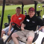 President Pribbenow & Erik Helgerson on a golf cart
