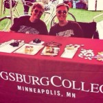 Provost Karen Kaivola and Bonnie Tensen, e-learning specialist, at Augsburg table for Twin Cities Pride.