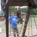 Andy Zetzman watches while his toddler climbs a jungle gym