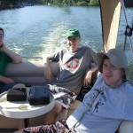 Andy Zetzman, Grant Jordahl, and Brad Motl on a boat