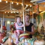 Sara (Prozinski) Motl and daughter Lilly on a merry-go-round