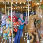 Oliver, Andy, Kara and Elsa on a merry-go-round