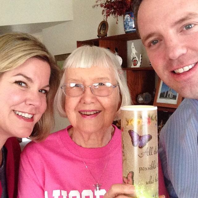 """Keith Stout and Kim Stone hanging out with Auggie Beth Opgrand '45 in Arizona in February. Her candle says, """"All things are possible for those that believe."""""""