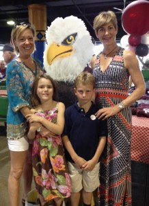 Lisa and Andrew Hawks pictured with Ann '96 and Tilly Webster at Auggie Night at the Races at Canterbury Park.