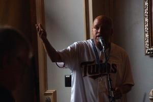 Robert Grace '98 addresses the Auggies.