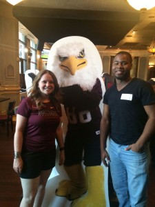 two Auggies pose with Auggie Eagle standup