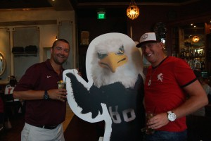 Auggies pose with Auggie Eagle stand-up figure