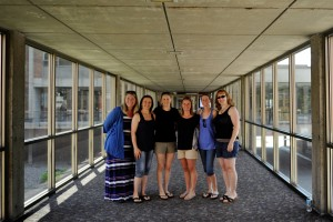 The 2001 grads pause for a quick photo in the link. (L-R) Erica Huls, Laura Waldon, Sara Thedinga, Stacy (Waterman) Newton, Emily Waldon, and Melon.