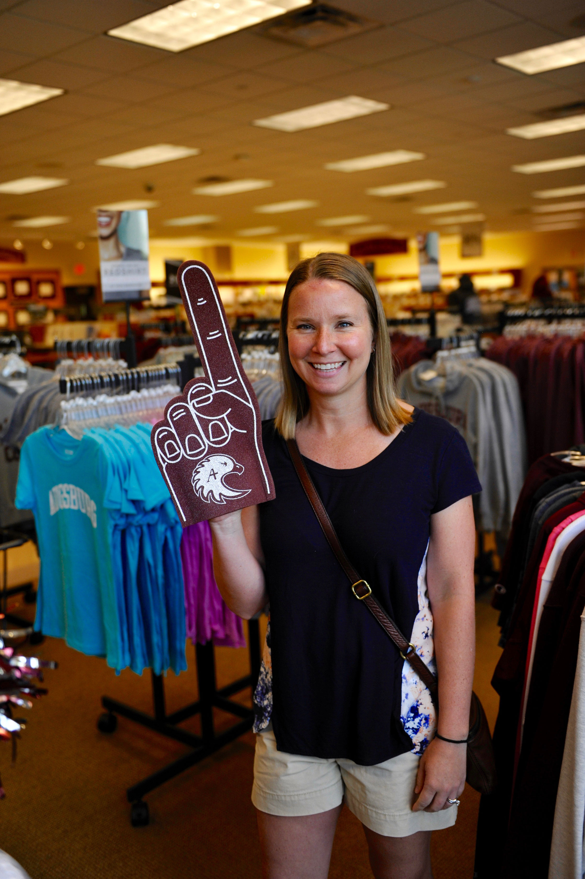 Taking a break in the bookstore, Stacy (Waterman) Newton affirms that Auggies are #1.