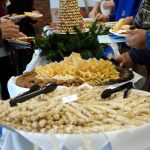 The Associates work tirelessly to bring a beautiful buffet to the Augsburg community.