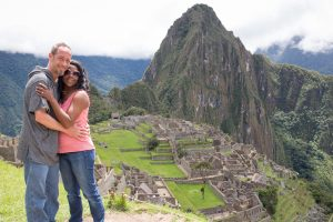 Stellner stands with her partner above the ruins of Machu Picchu