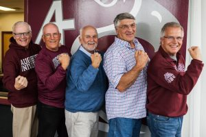 The four friends posing with their arms in gun (L-R Tim Casey, Mike Scott, Bruce Santerre, Larry Stewart and Mike Good)