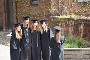 Group of Augsburg grads taking a photo