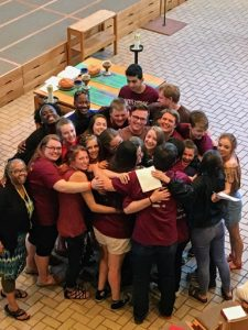 Students group hug in the chapel