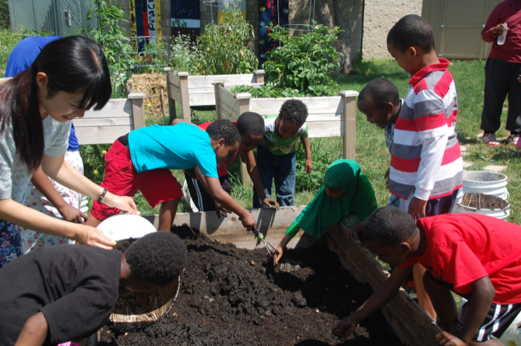 youth in the Brian Coyle Center garden