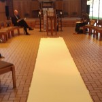 a large strip of paper down the middle of the chapel