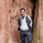 erik leaning against rock