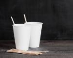 two white paper cups with wooden stir sticks