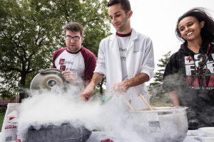 student and professor working with liquid nitrogen