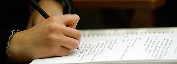 Photo of Notebook with Student Taking Notes