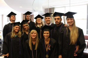 Ten StepUP graduates from 2010 posing in their caps and gowns