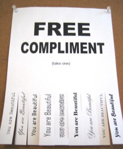 """A piece of paper that reads """"Free Compliment"""" following a list of compliments."""
