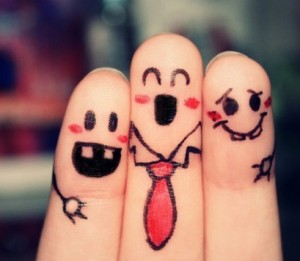 Three fingers with faces drawn on them.