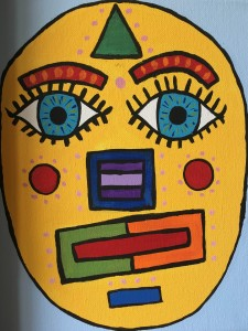 A painting of a yellow face.