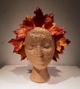 Gold head and orange autumn leaves sculpture.