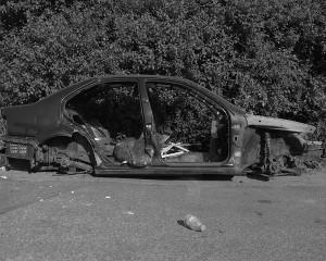 Black and white photo of a taken apart car.