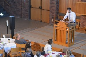 Caleb K. speaking at National Recovery Month's spirituality breakfast. Photo by Ricky T.
