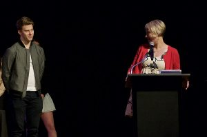 Photo of Christian J and Kristin Wilcox on stage
