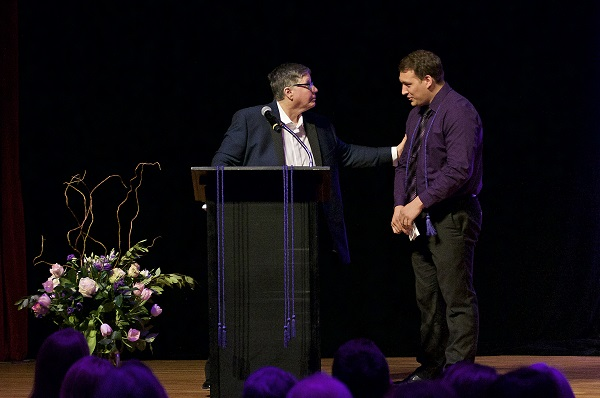 Photo of Patrice introducing Blake H. to the stage