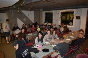 StepUP students sitting for thanksgiving dinner