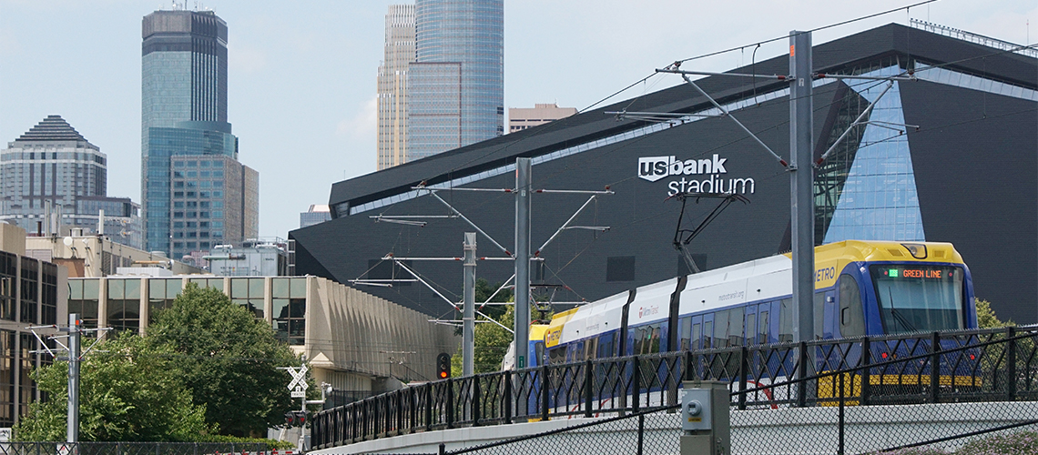US Bank Stadium with Minneapolis skyline in background