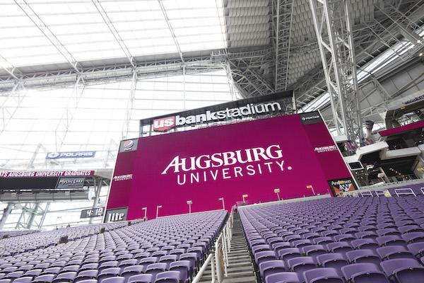 Augsburg University sign displays in U.S. Bank Stadium