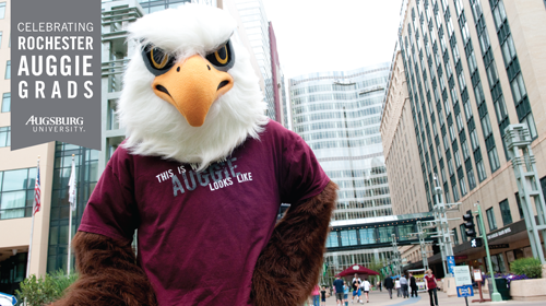 "Zoom background with banner ""Celebrating Rochester Auggie Grads Augsburg University"" with Auggie Eagle"