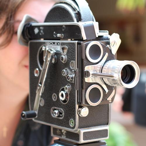 student behind a camera