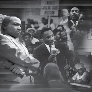 Black and white photo of Martin Luther King Jr. speaking to a crowd