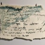 a piece of paper with indecipherable writing
