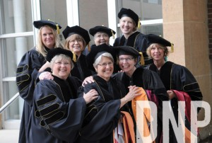 In a photo with her Doctorate in Nursing Practice cohort, Kinney is in the back row, second from right,