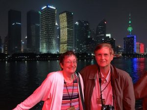 Miriam and Ron Peterson with Shanghai in the background.