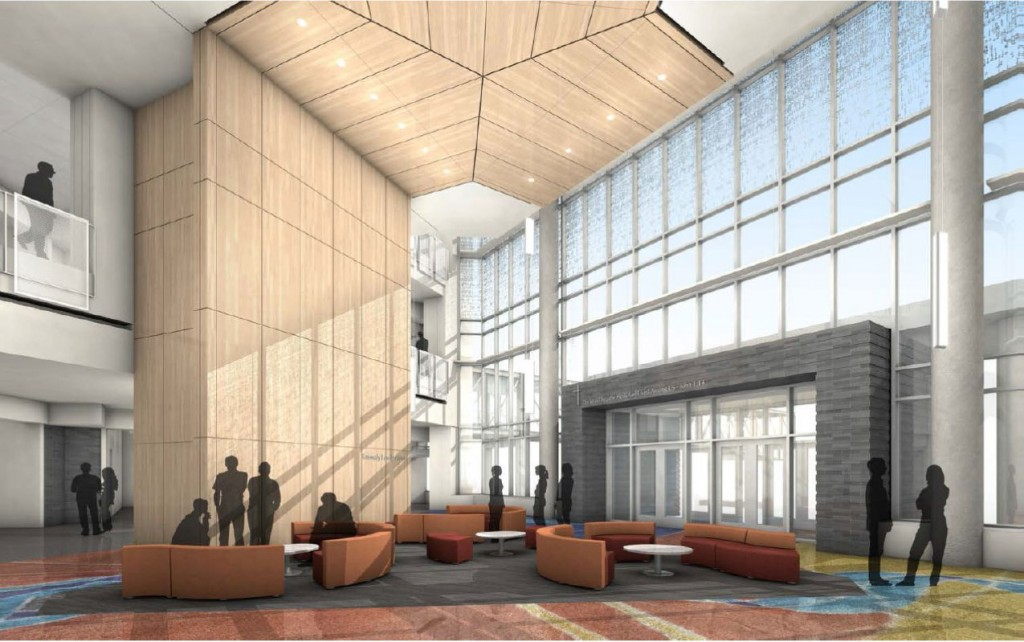 A digital representation of the design for the Hagfors Center learning commons. The room features a high-ceiling, a wall of windows, a colorful inlay design floor, and couches and tables