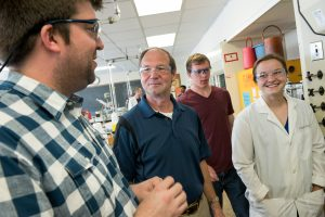 Terry Lindstrom '73, shown with Professor Michael Wentzel, Adam Pancoast '18, and Taylor Mattice '18, a Regents and Honor Scholar. In 2016, Lindstrom funded 10 weeks of summer research for Mattice, Pancoast, and two other students.
