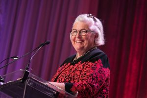 A smiling Cindy Piper at the podium at the 2016 StepUP Gala.