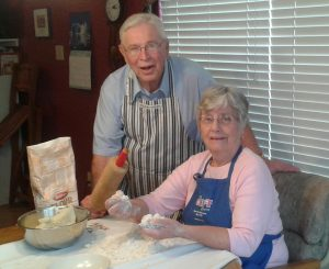 The Egertsons in their home making lefse