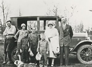 Hjelmeland family in the mid 1920s with Rev. John Hjelmeland pictured far right